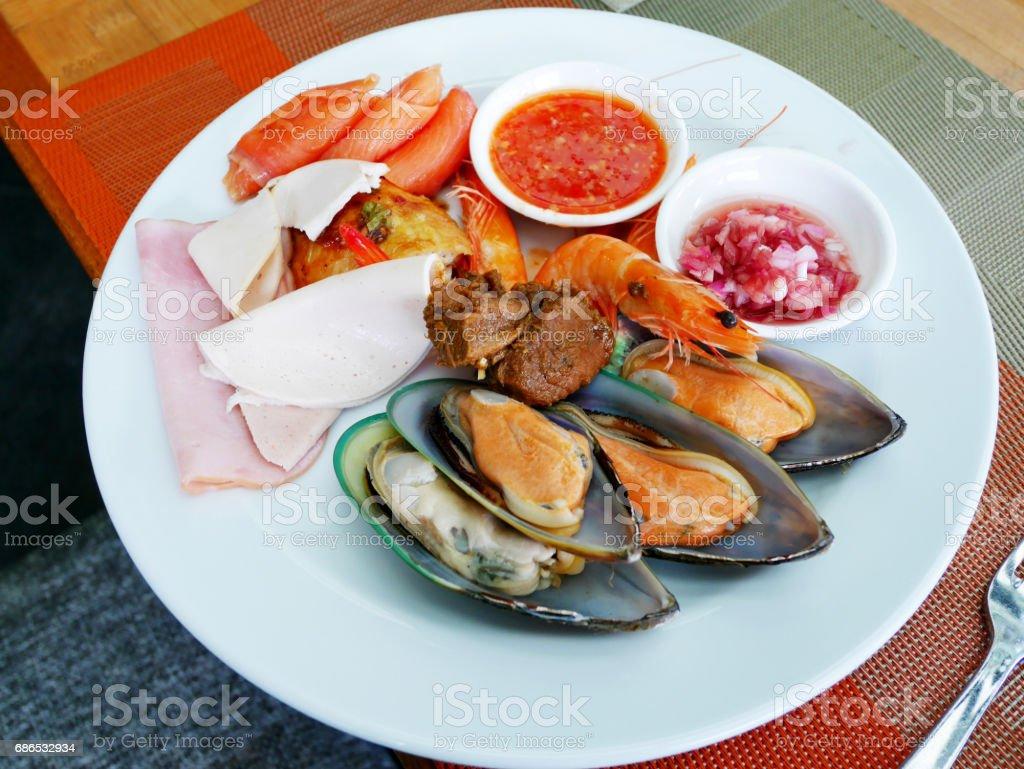 Thai people serve cuisine on plate at food buffet zbiór zdjęć royalty-free