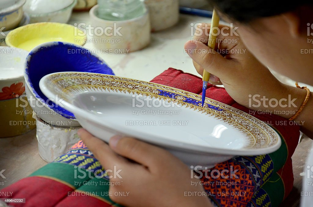 Thai people woking process paint Ceramic Benjarong is traditiona stock photo
