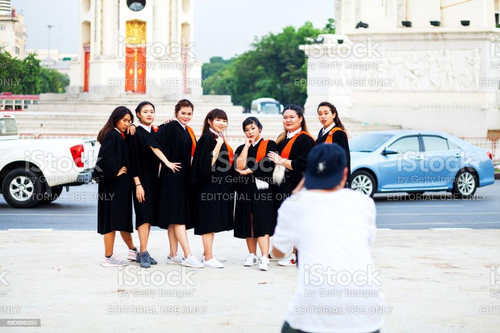 Thai photographer shoots thai student girls for graduation royalty-free stock photo