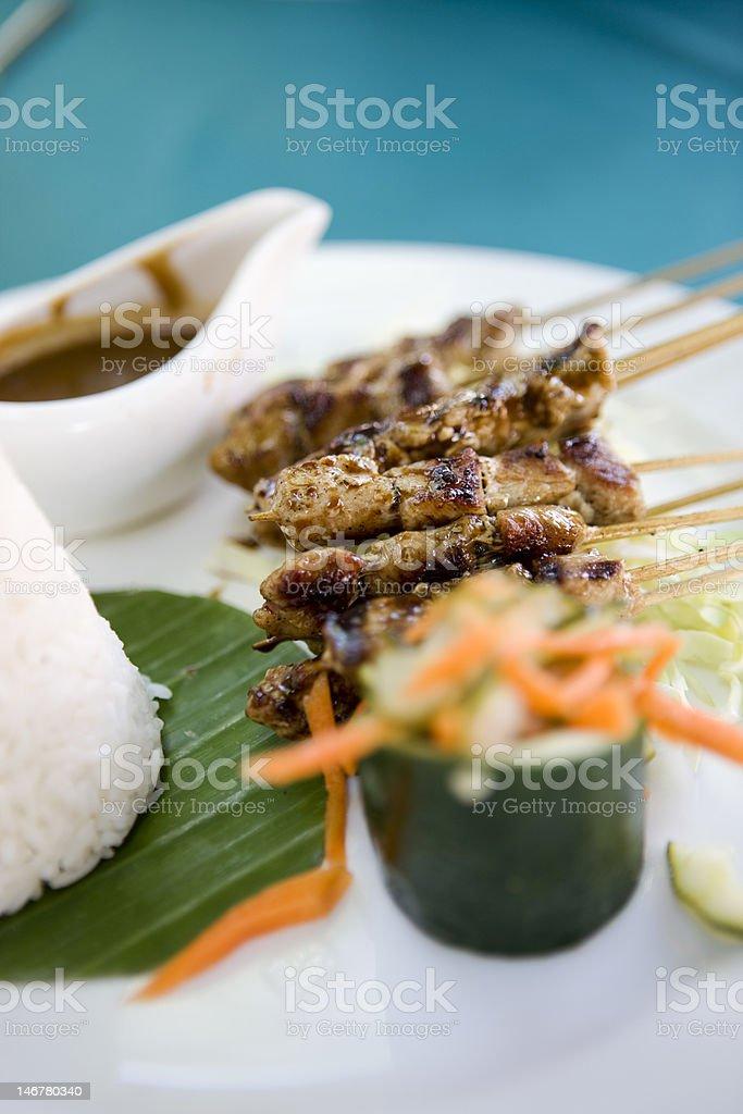 Thai pork and chicken satay sticks with rice & salad royalty-free stock photo