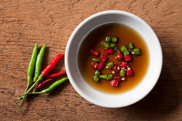 Thai red and green chili in bowl of fish sauce. stock photo
