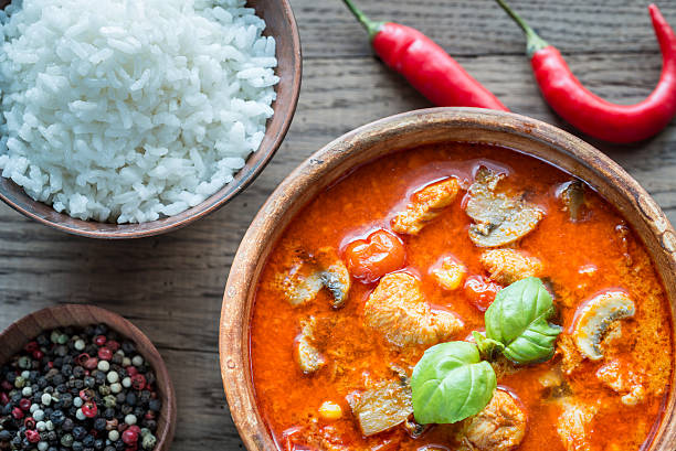 thai red chicken curry with white rice - thai culture stock photos and pictures