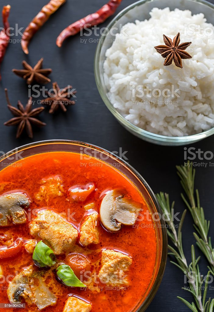 Thai red chicken curry with white rice stock photo