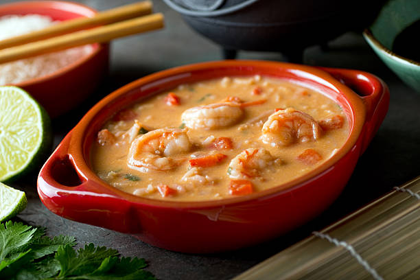 Thai Red Curry Coconut Shrimp Soup With Rice stock photo