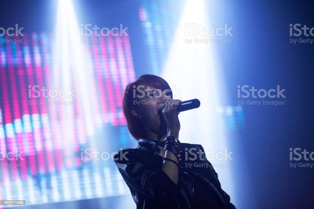 Thai rock singer in light beams stock photo