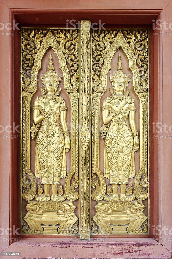 Thai sculpture style on temple door stock photo