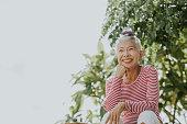 istock Thai senior hipster portrait beside the garden 1262684396