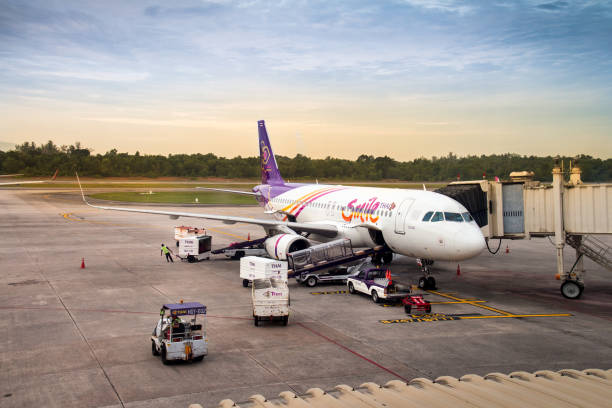 Thai Smile airline parking at the terminal during sunrise at Hat Yai International Airport in Songkhla Province, Thailand stock photo
