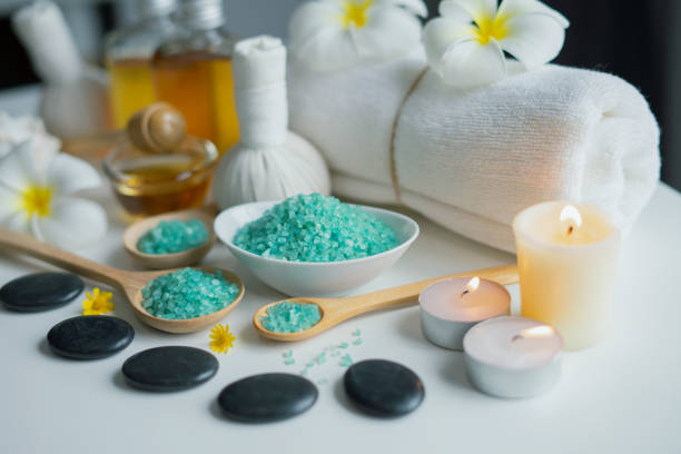 Thai spa massage compress balls and salt spa objects on table background stock photo