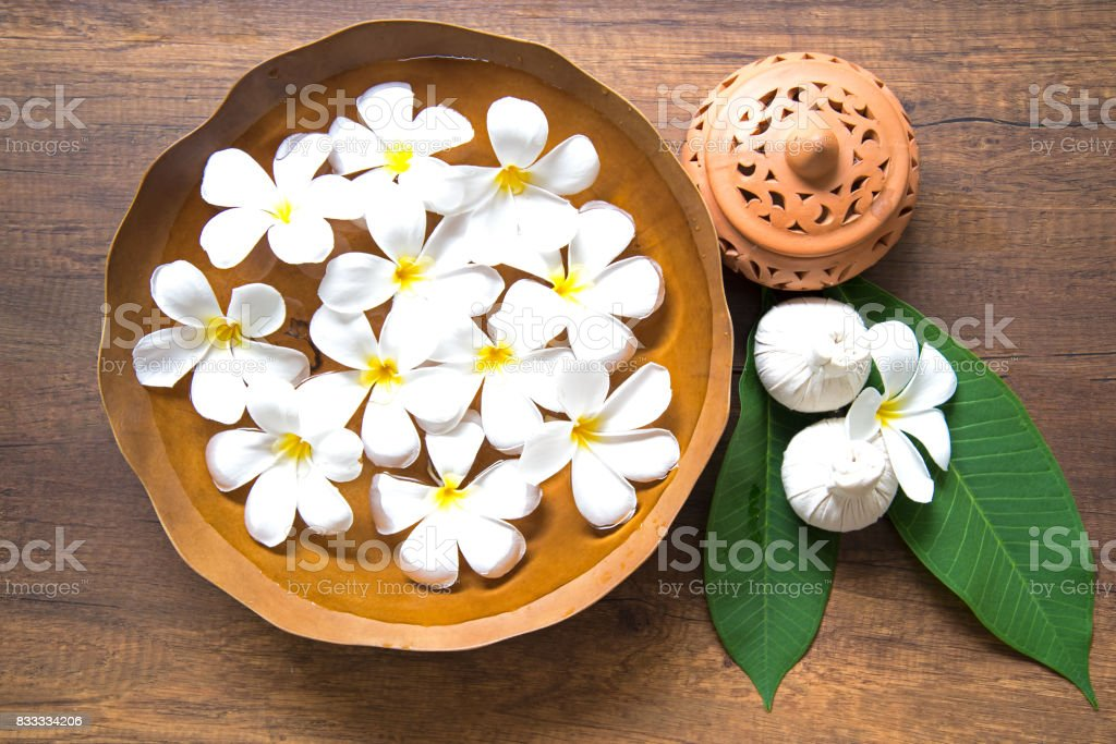 Thai Spa massage compress balls, herbal ball and treatment  spa, relax and healthy care with flower, Thailand.  Healthy Concept. select focus stock photo