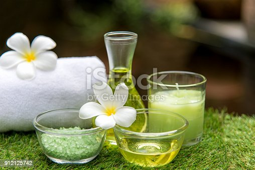 istock Thai Spa massage compress balls, herbal ball and treatment spa, relax and healthy care with flower, Thailand. Healthy Concept 912125742
