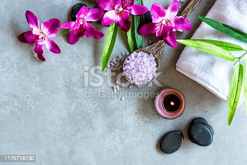 istock Thai Spa. Top view of hot stones setting for massage treatment and relax with purple orchid on blackboard with copy space.  Lifestyle Healthy Concept 1175716130