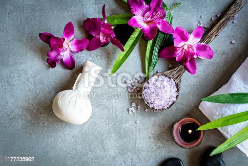 istock Thai Spa. Top view of hot stones setting for massage treatment and relax with purple orchid on blackboard with copy space.  Lifestyle Healthy Concept 1177235962