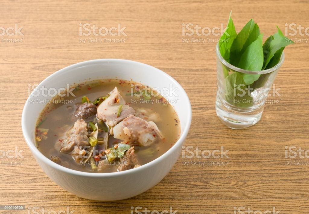 Thai Spicy Beef Entrails Soup with Sweet Basil stock photo