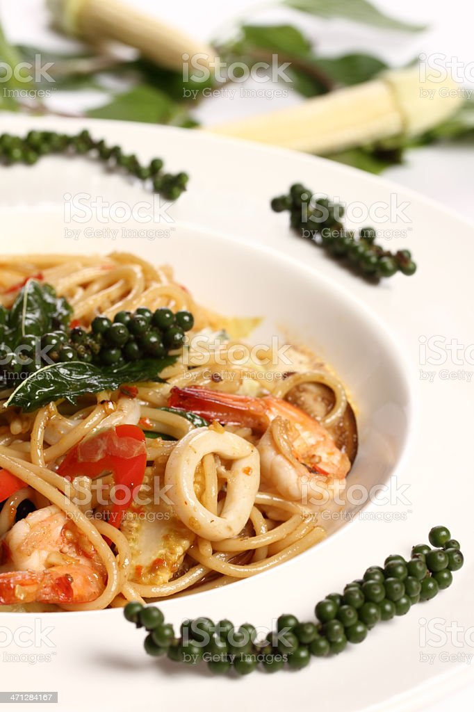 Thai spicy spaghetti seafood with green pepper stock photo