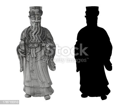 thai statue of an old noble man with a long beard and a scroll in his hand in traditional thai clothes, and his silhouette