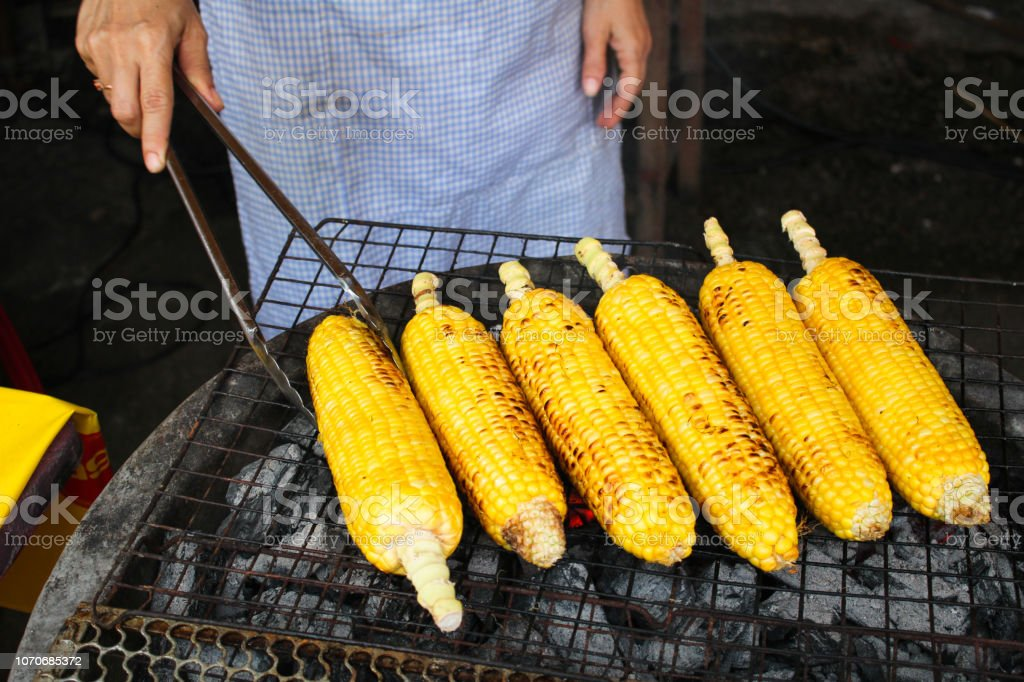 Thai street food market - Corn on the cob cooked on BBQ stock photo