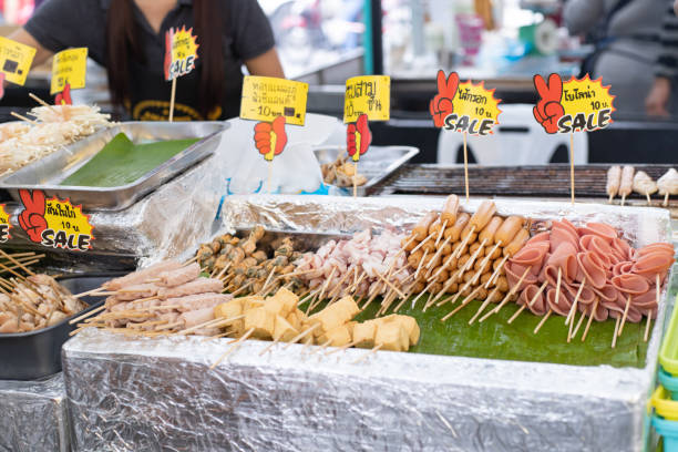 Thai street food. Meatballs, hot dogs, sausages in the market. stock photo