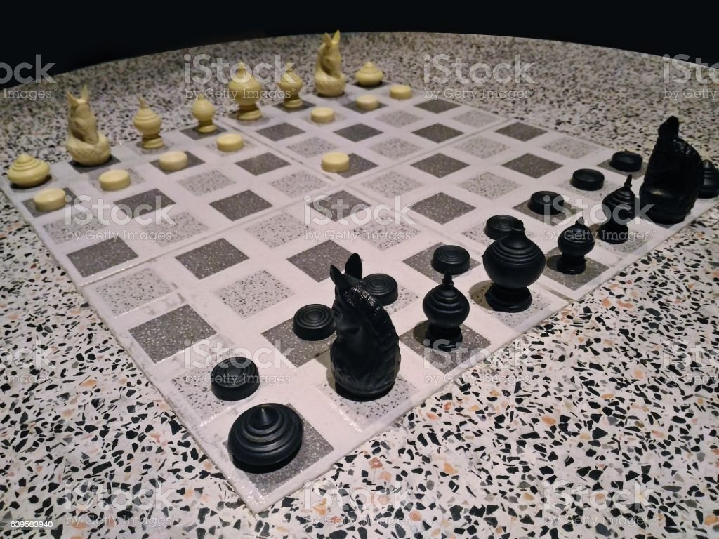Thai style chessmen on round marble table stock photo