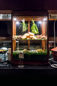 Thai style noodle showcase with wood finishing in vintage style for noodle ingredients in dinner buffet line at hotel restaurant.