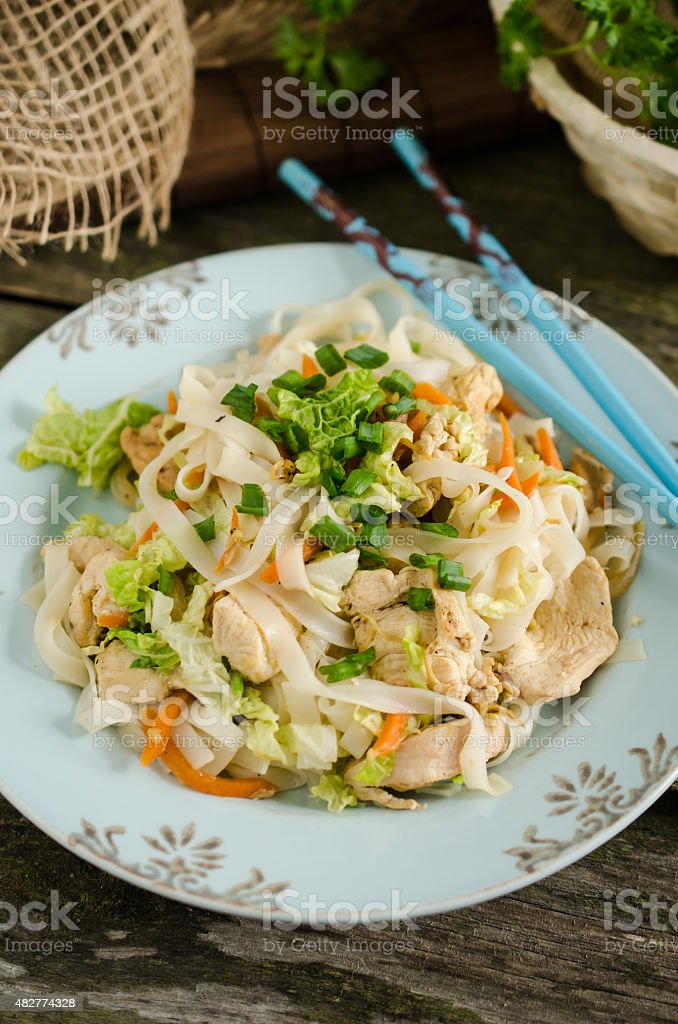 Thai style noodles with chicken and chinese cabbage stock photo