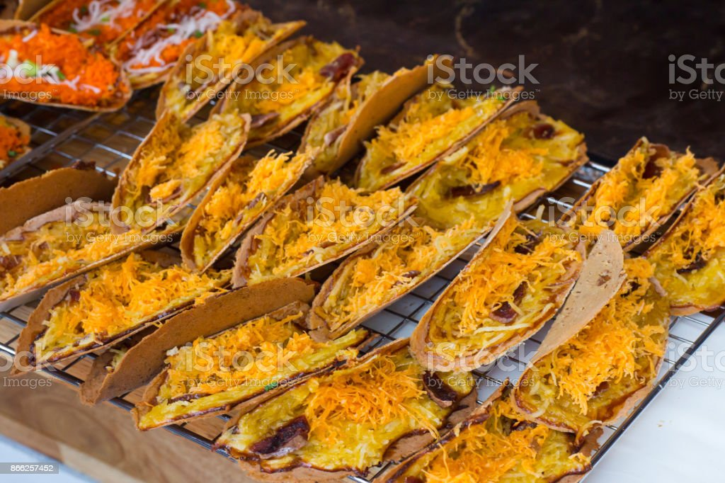 Thai style stuffed crispy stuffed with sweet coconut and Thai sweet golden threads. stock photo