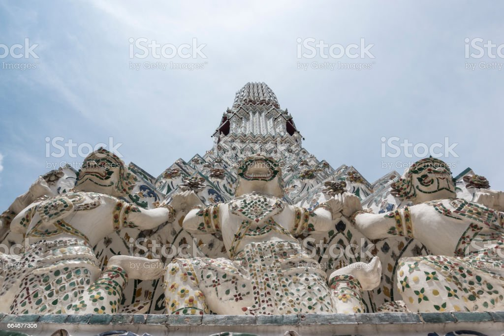 Thai style temple decoration of mosaic on blue sky at Wat Arun(Temple of dawn) stock photo