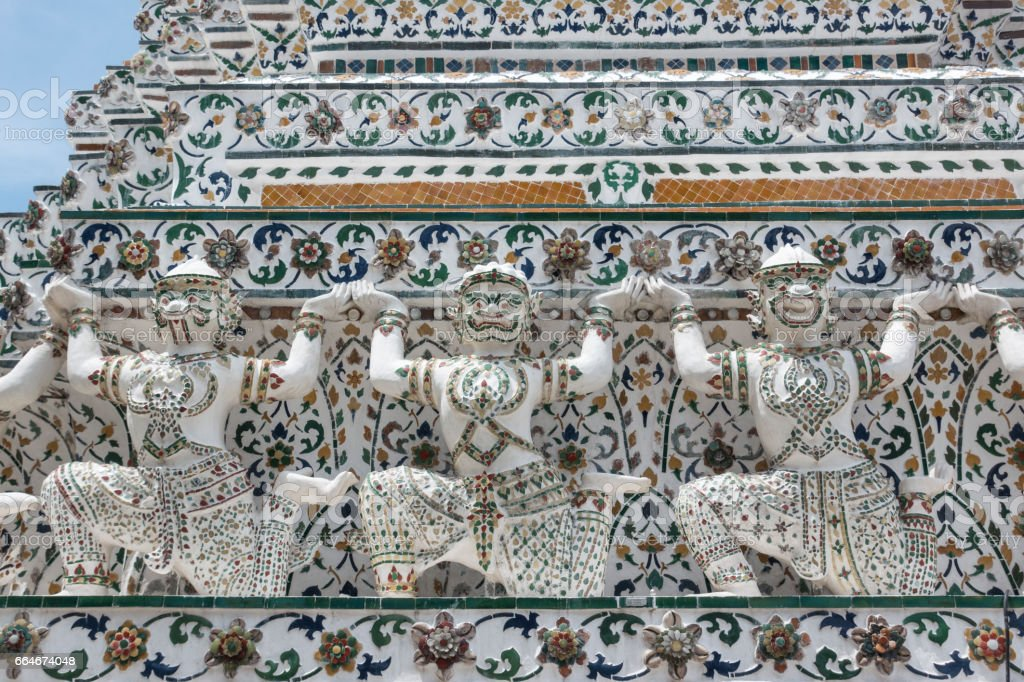 Thai style temple decoration of mosaic on blue sky background stock photo