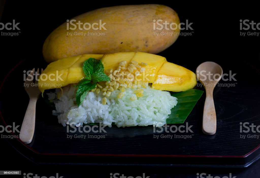 Thai style tropical dessert, glutinous rice eat with mangoes - Royalty-free Coconut Milk Stock Photo