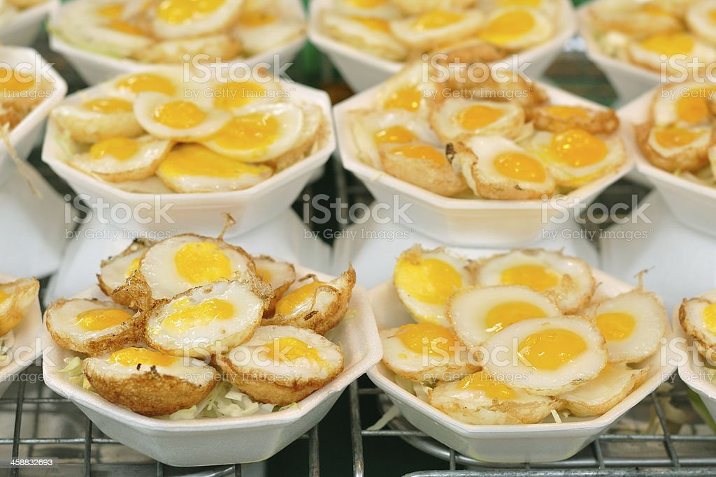 Thai sweetmeat made from small eggs put in bowl foam. stock photo