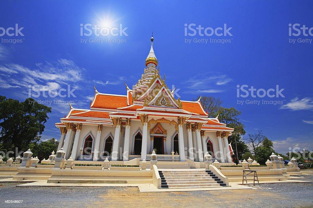 Thai temple against sunbeam and blue sky stock photo