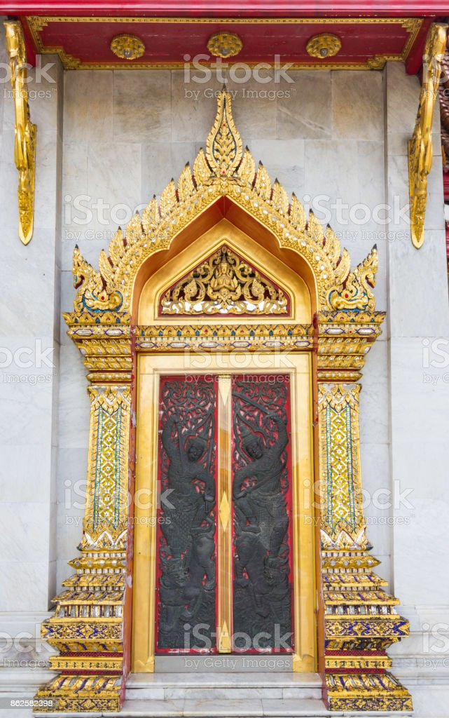Thai temple door sculpture stock photo