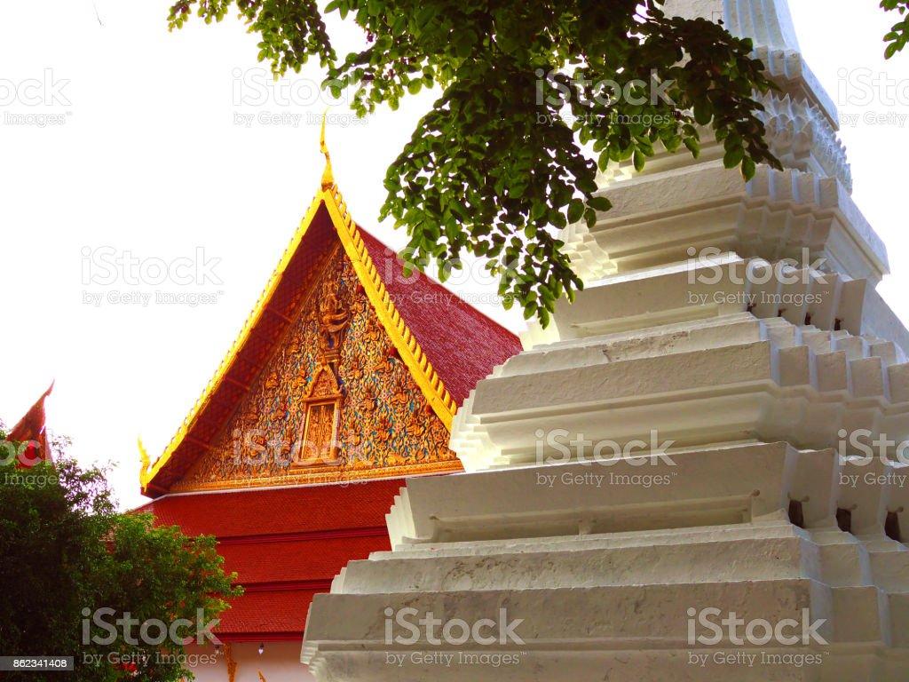 Thai temple house and white pagoda, green trees, white background stock photo