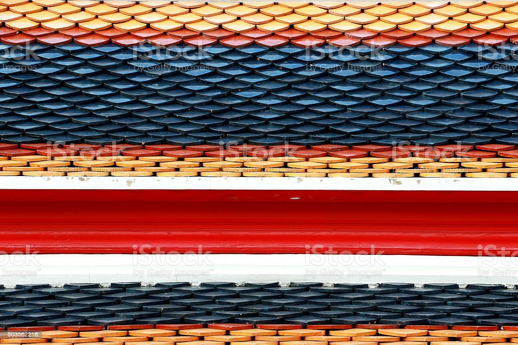 Thai Temple Roof Tile Display in Thai Flag Pattern stock photo