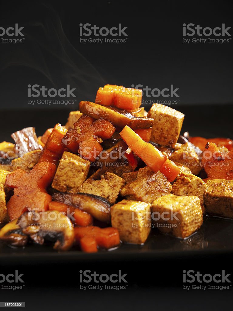 Thai tofu with carrots and mushrooms royalty-free stock photo