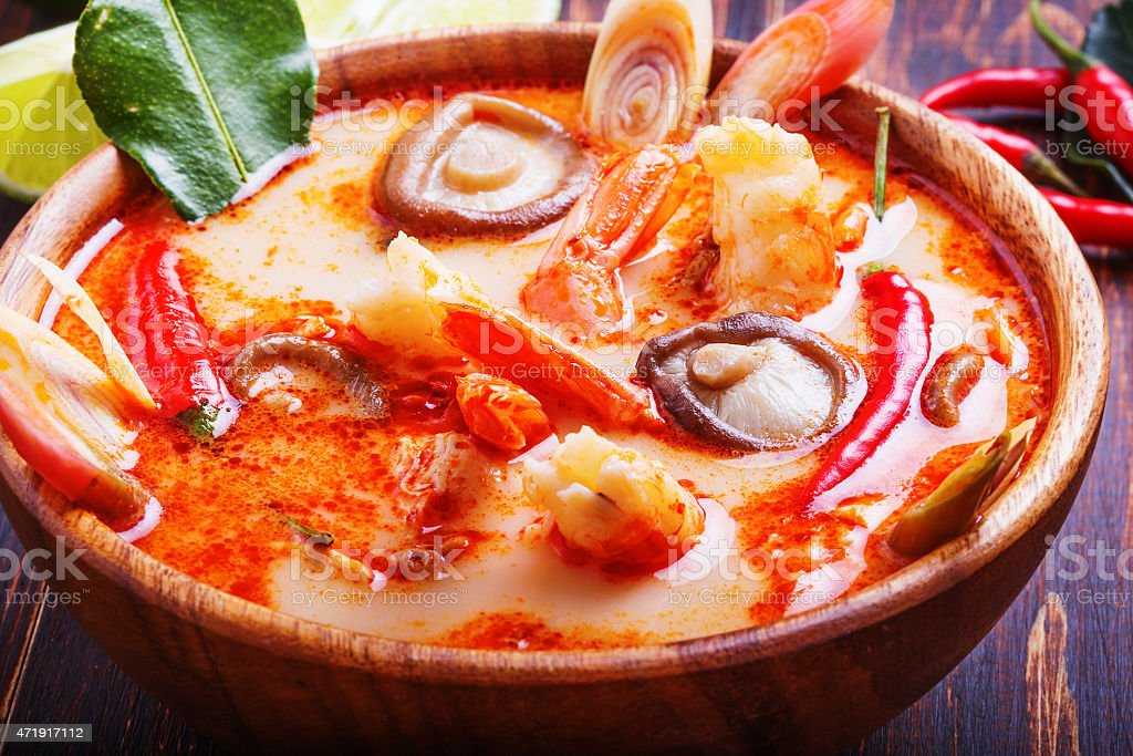 Thai Tom Yam soup with shrimp and  mushrooms stock photo