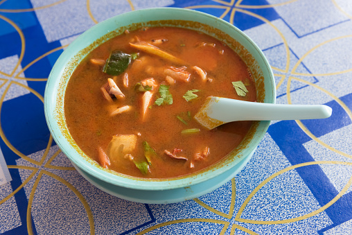 Asian hot and sour soup  (Tom Yum Kha)  soup at road side cafe
