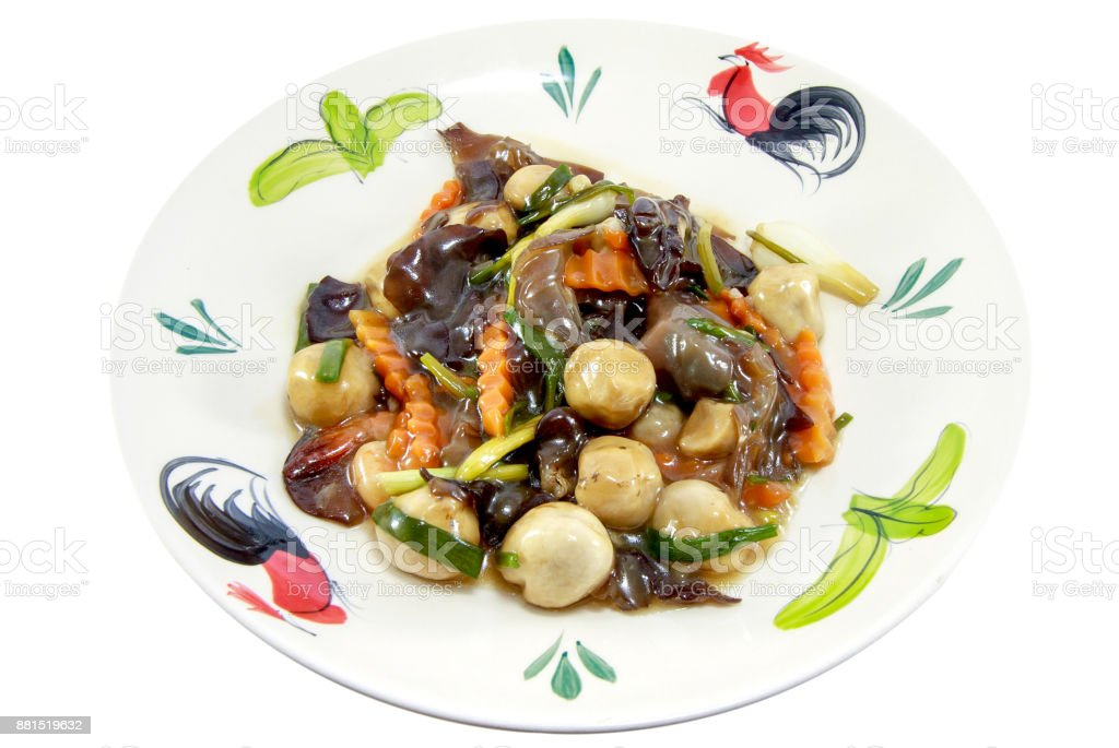 Thai traditional cuisine roasted mushrooms with dill on the white plate isolated on white background, asian eating food, Thai food, close up stock photo