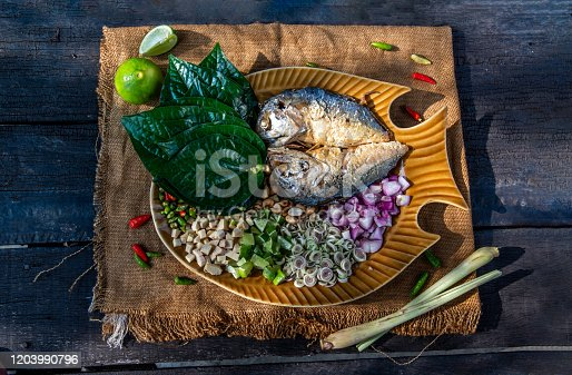 Thai Traditional Food : Fried mackerel served with fresh vegetable and herb, This food is thai food call Meuang Mackerel (Maing-Pla-too) menu.