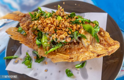 Grilled fish with herbes from thai cuisine
