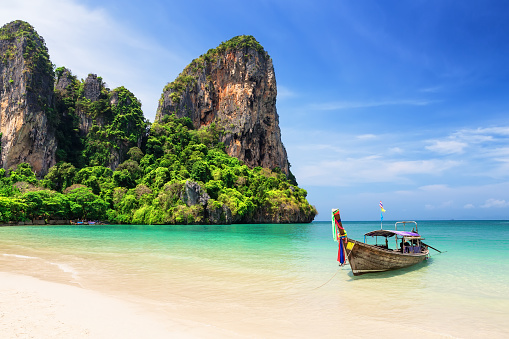 istock Thai traditional wooden longtail boat and beautiful sand beach 1011241694