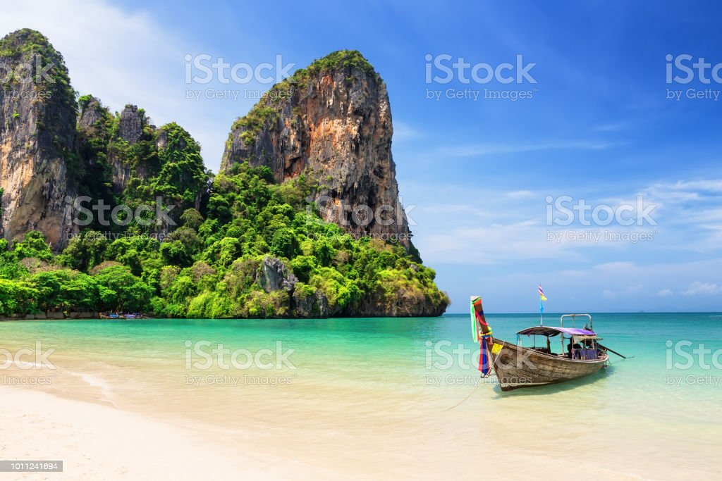 Thai traditional wooden longtail boat and beautiful sand beach stock photo