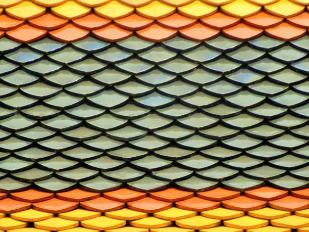 Thai vibrant colored temple tiled roof stock photo