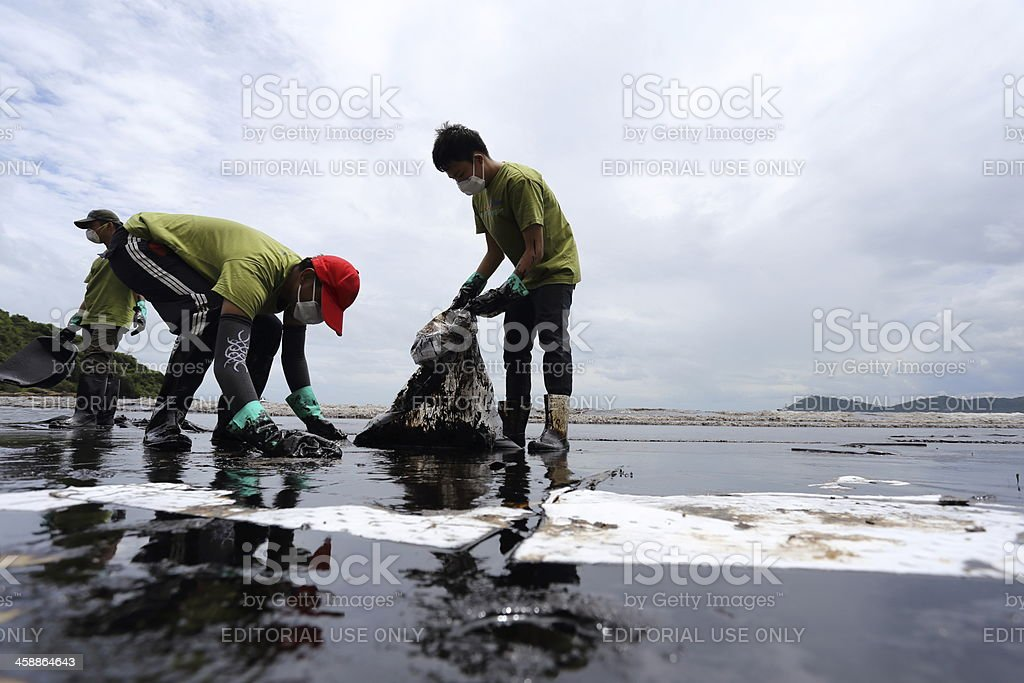 Thai volunteers have cleaned oil stains stock photo