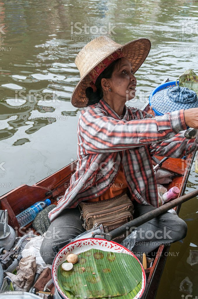 Thai Woman At Floating Market stock photo