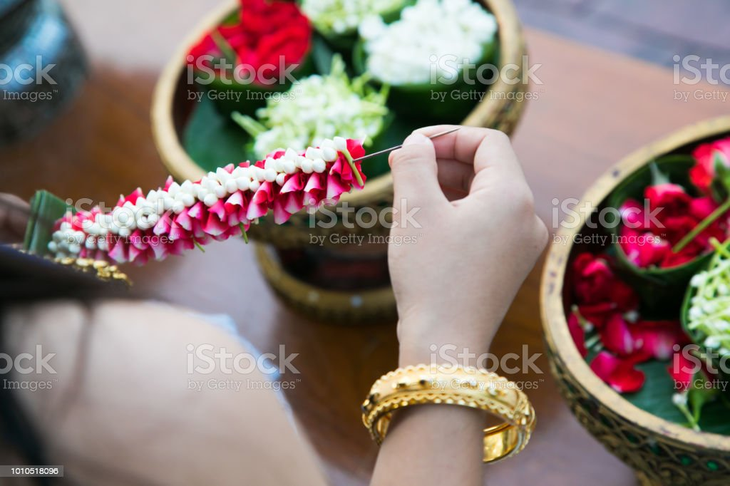 Thai Woman Making A Tradition Thai Flowers Garland Stock Photo