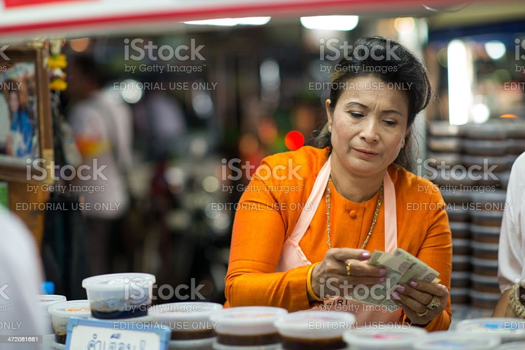 Thai woman returns the change stock photo