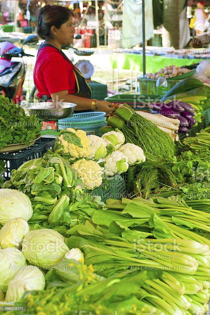 Thai woman selling greengrocery at market royalty-free stock photo
