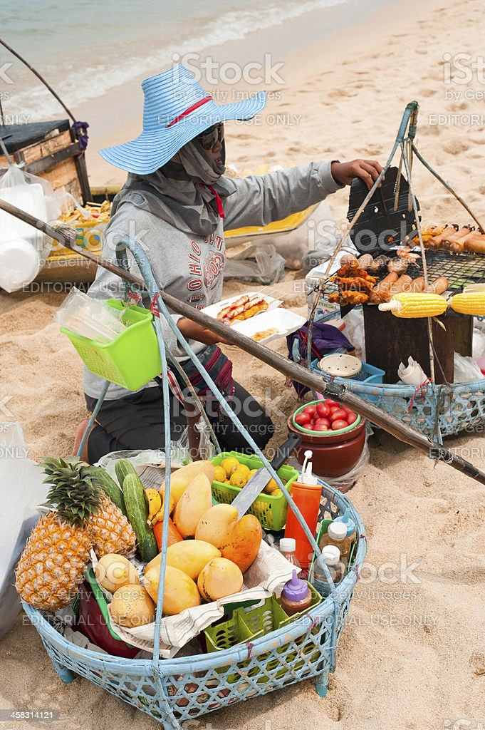Thai woman selling traditional food at beach royalty-free stock photo