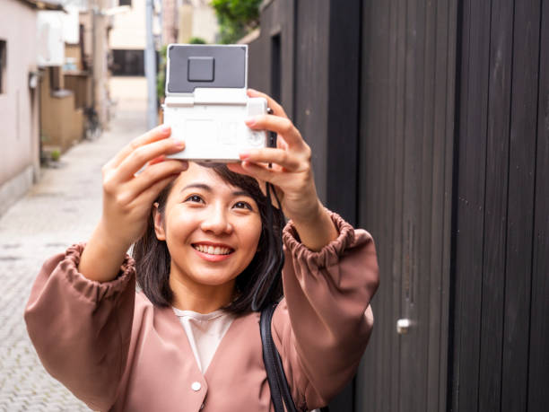 Thai woman taking selfie at old town in Tokyo. stock photo